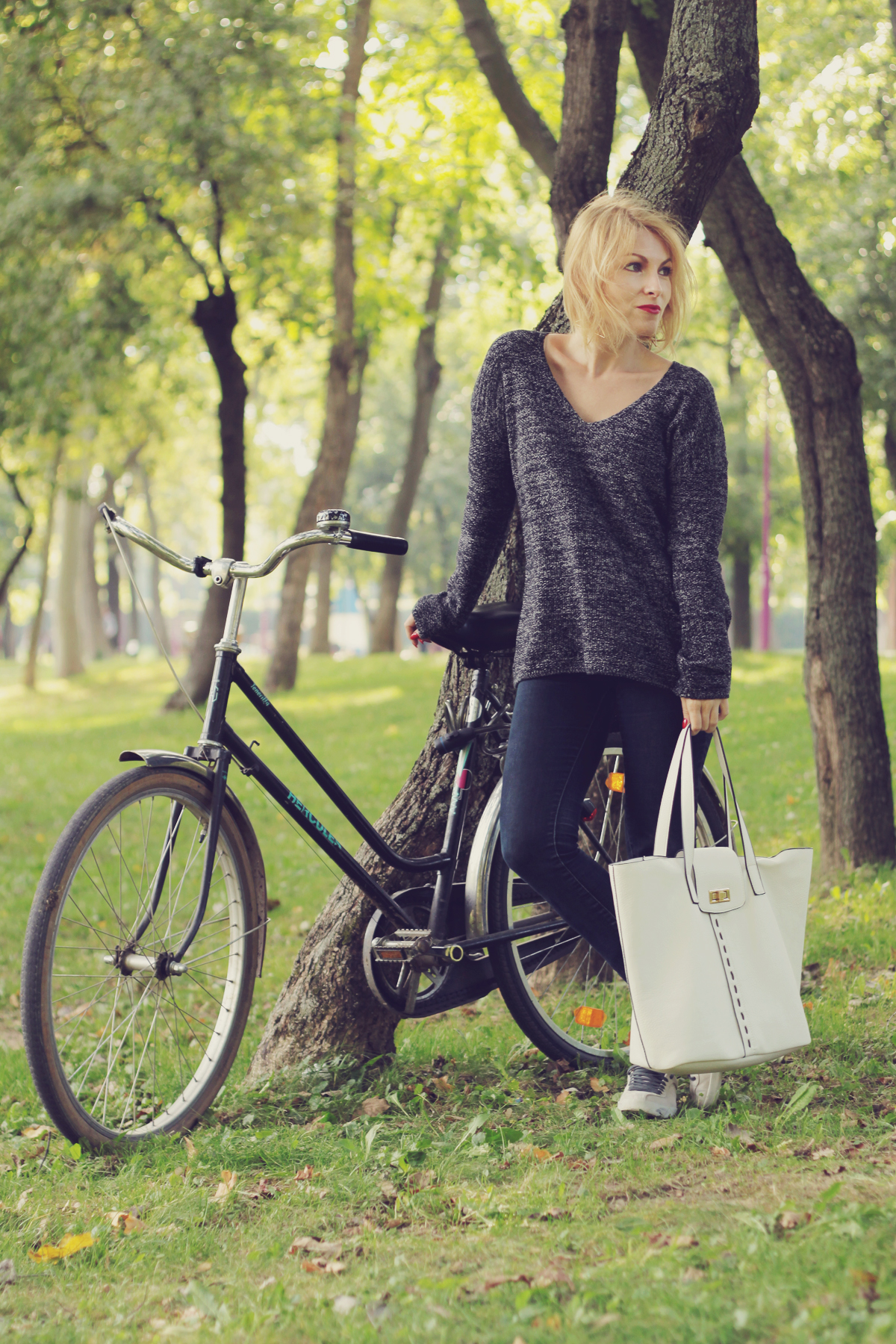 bike jeans and large white bag