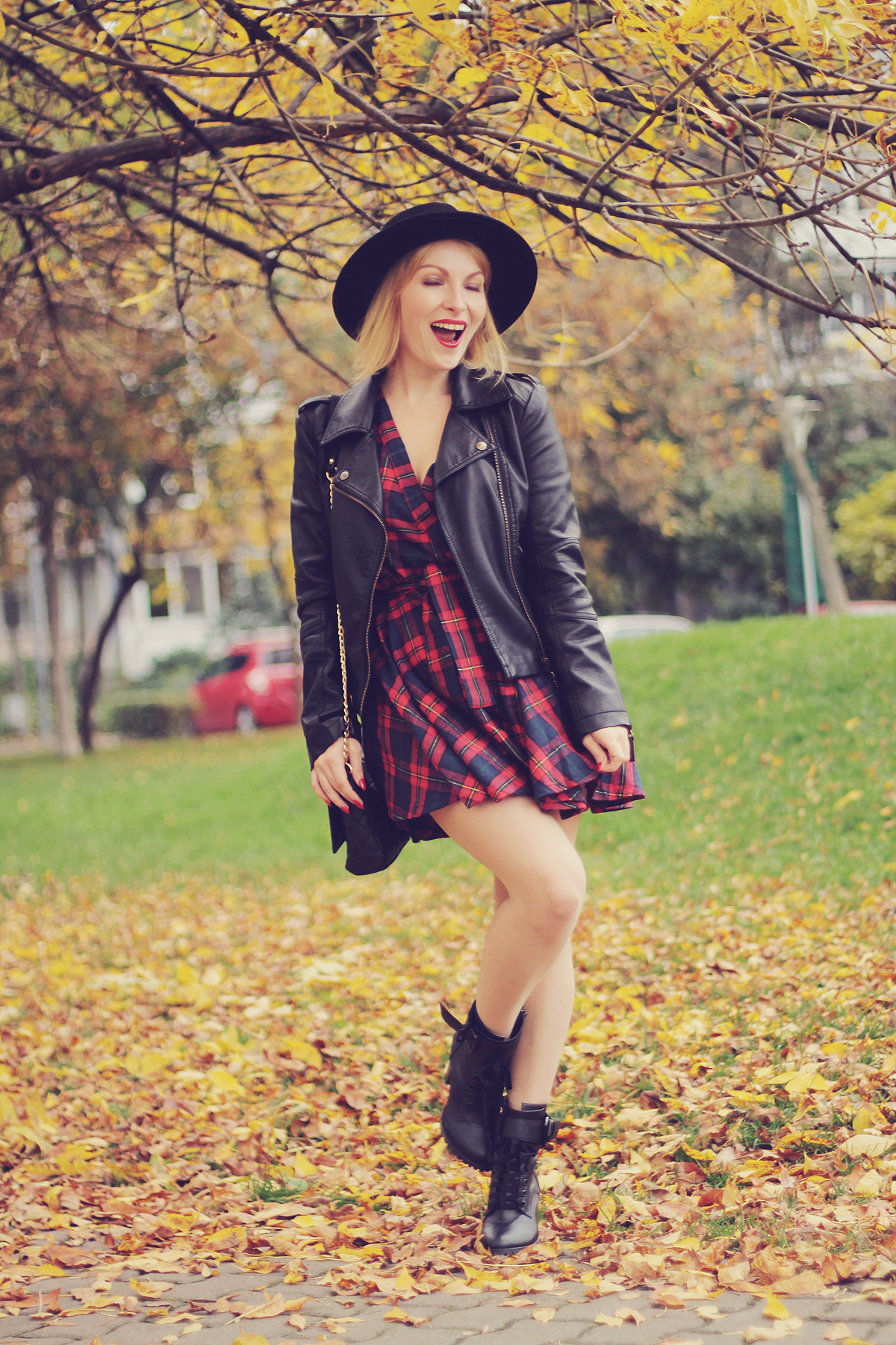 fall outfit tartan dress and leather jacket
