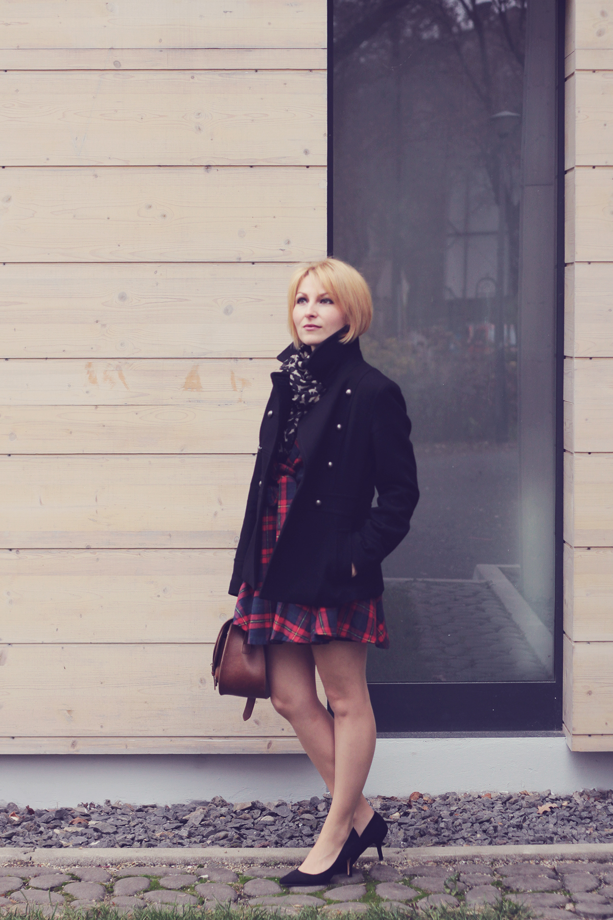 black coat_tartan dress and heels