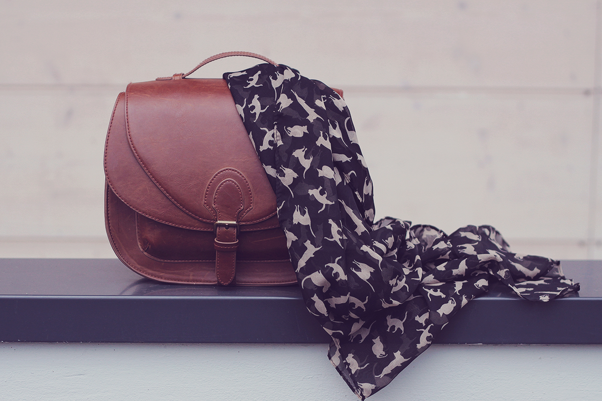 cat pattern scarf and brown handbag