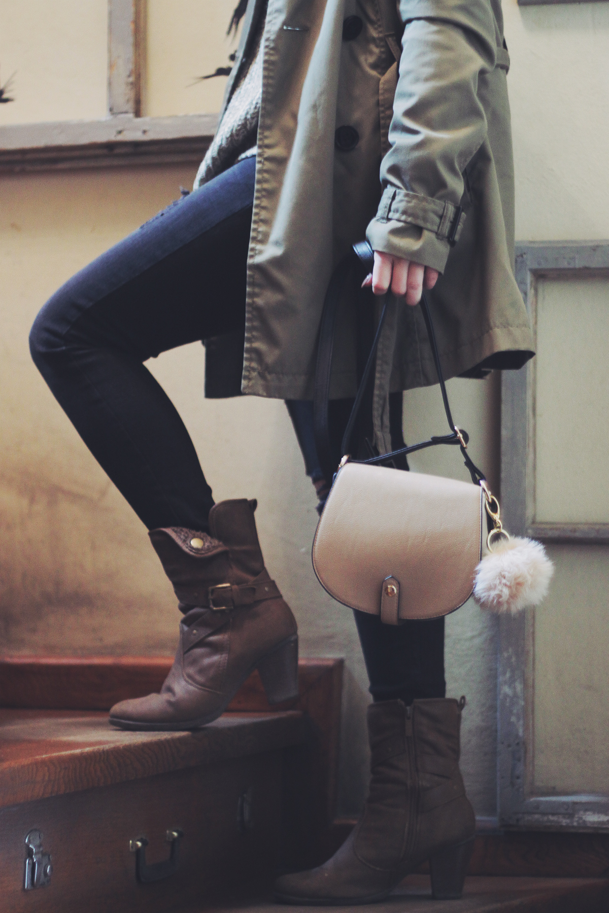 purse with pompom and boots