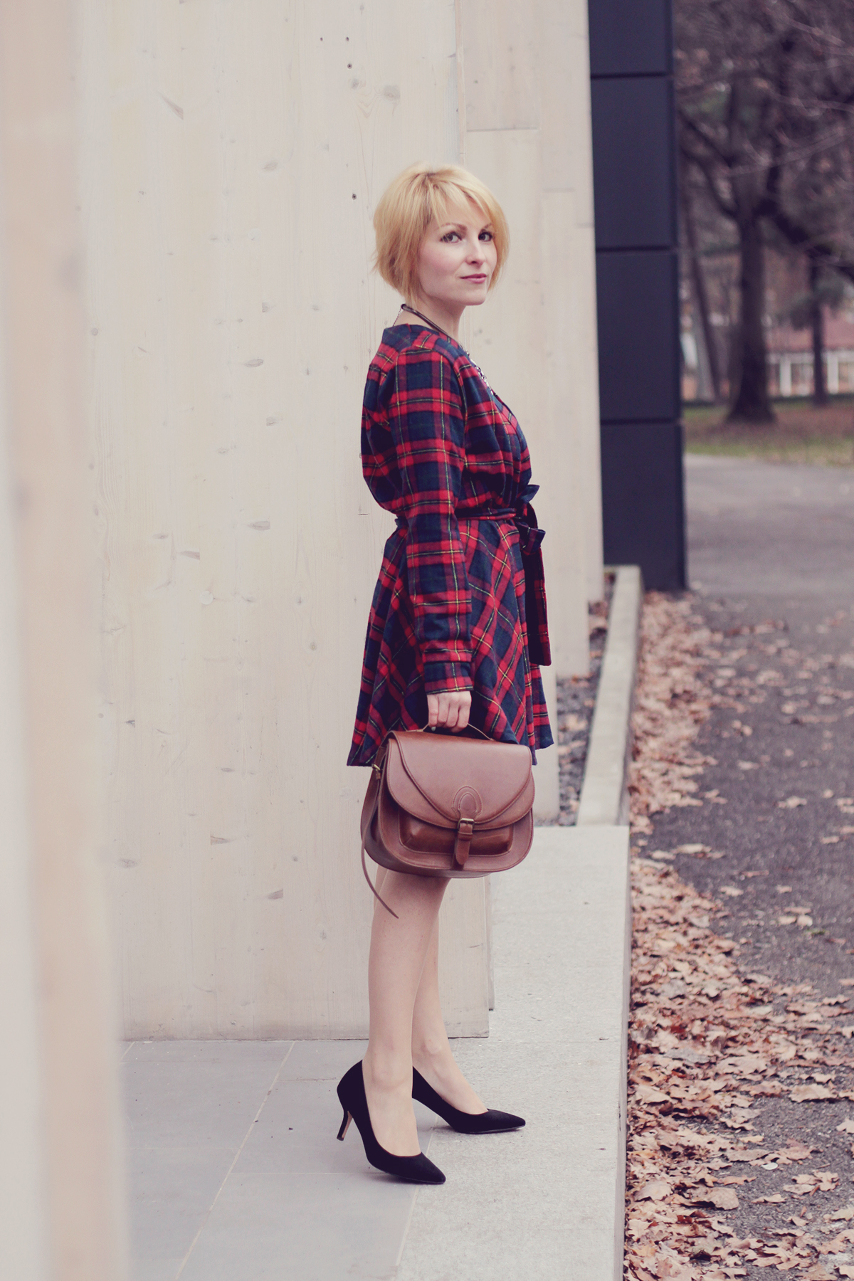 tartan dress and brown handbag