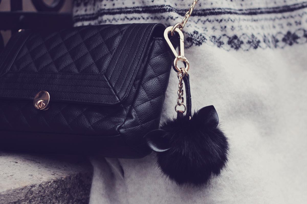 cute black pom-pom with ears