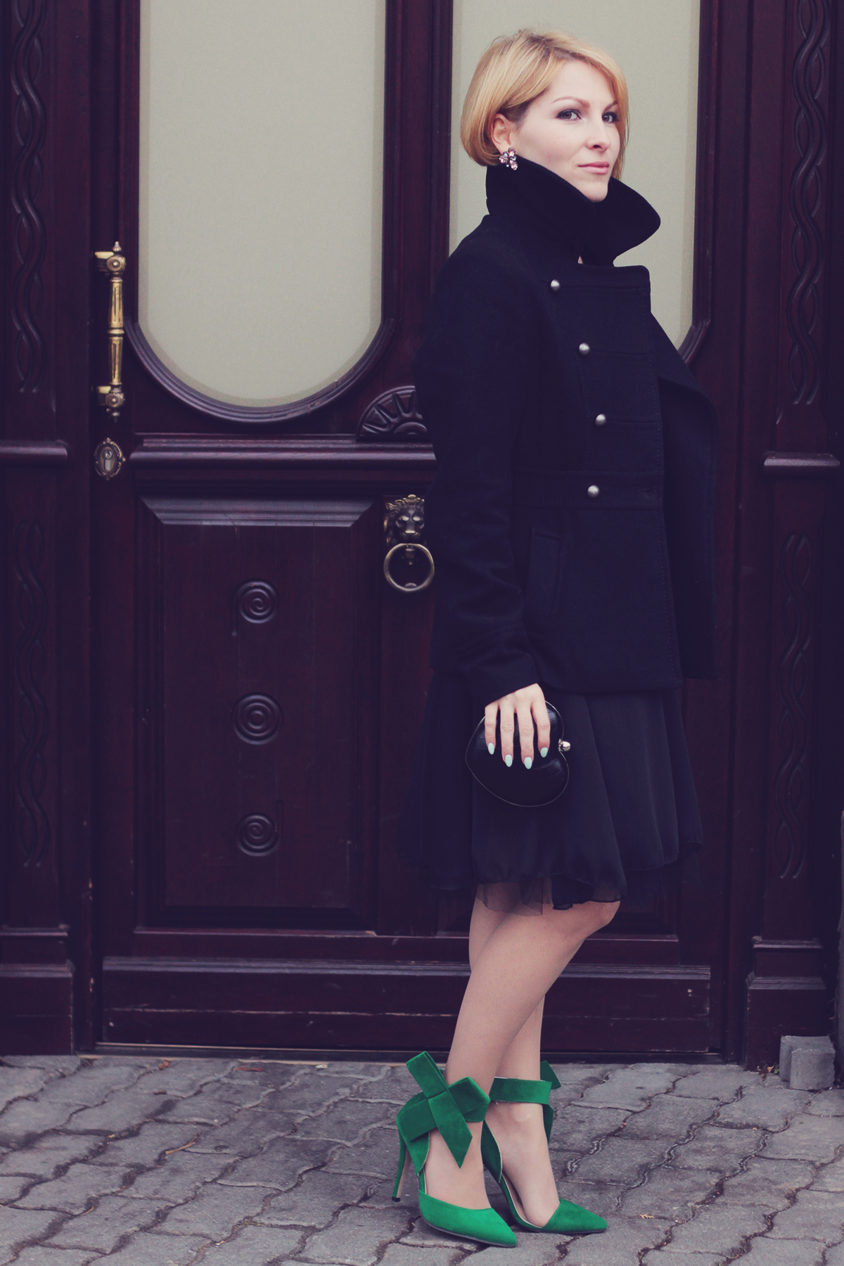 holiday look-black coat and dress with big bow high heel stilettos