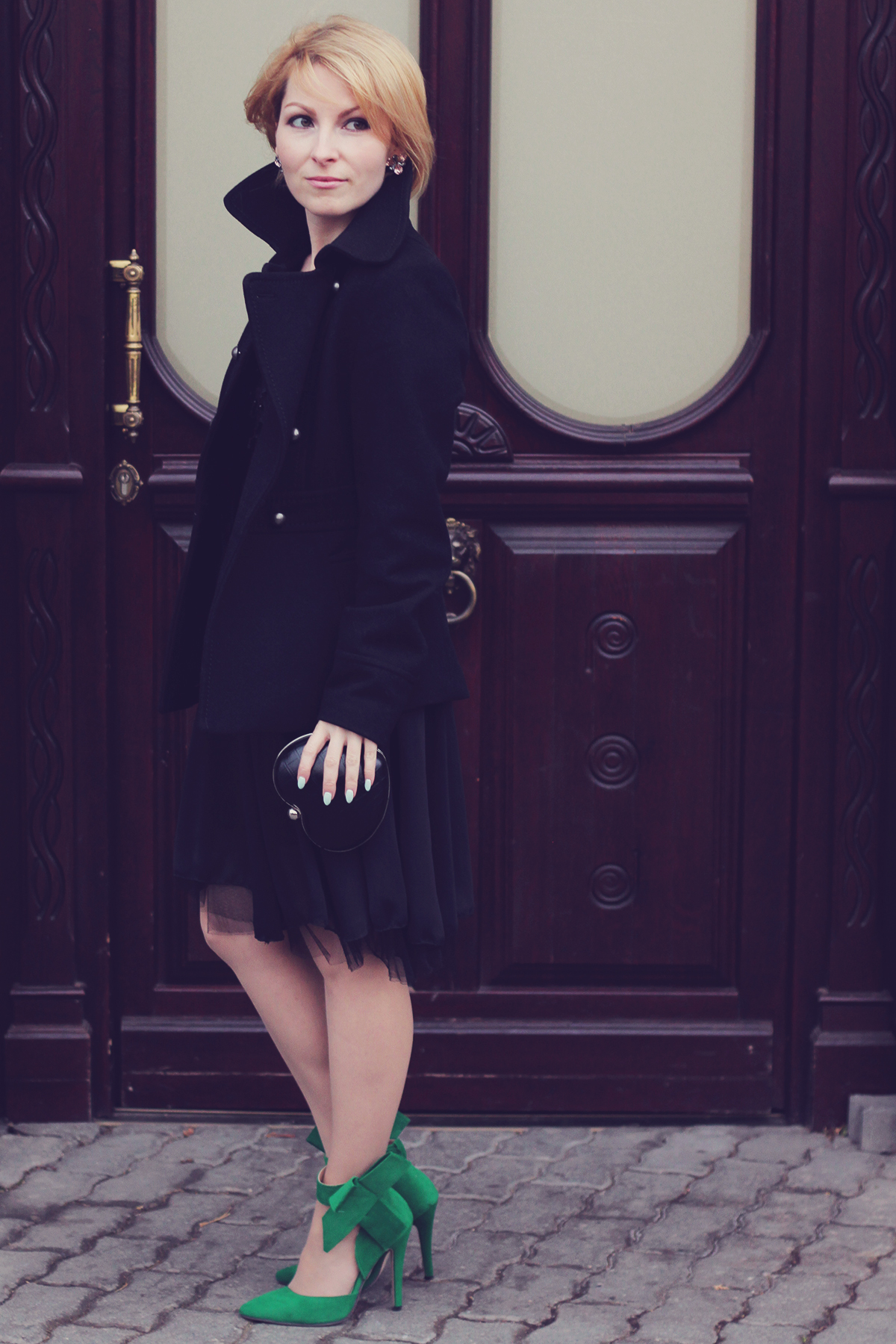 holiday look-black dress and coat with the big bow high heel stilettos