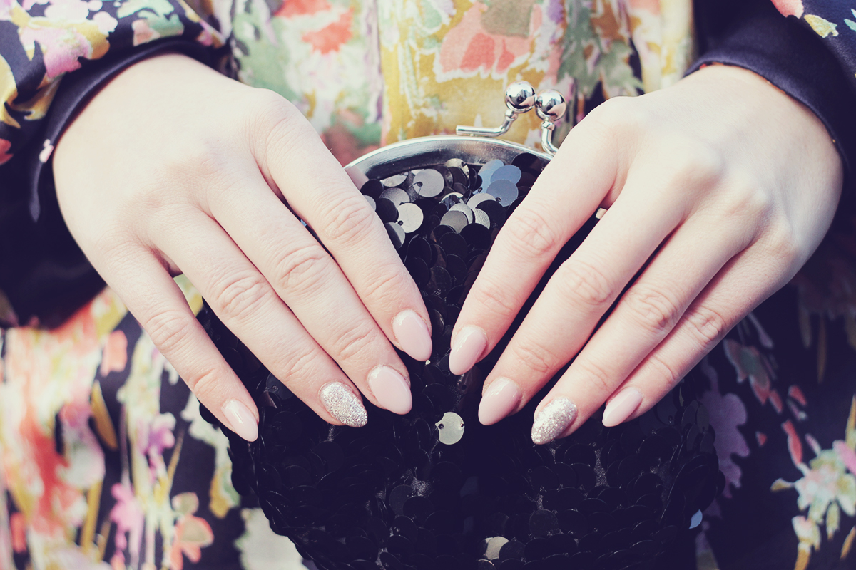 nude nails and sparkle black clutch