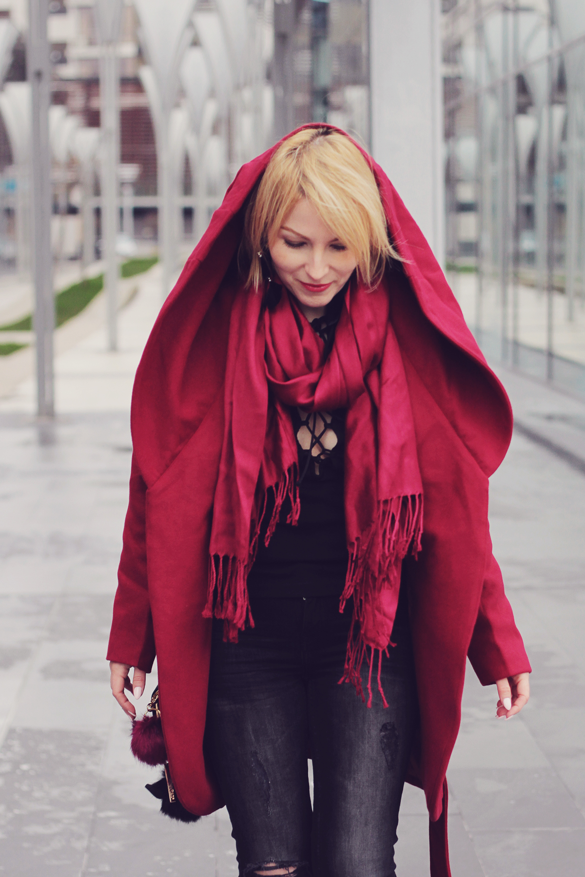 burgundy coat and scarf with cut-out jeans