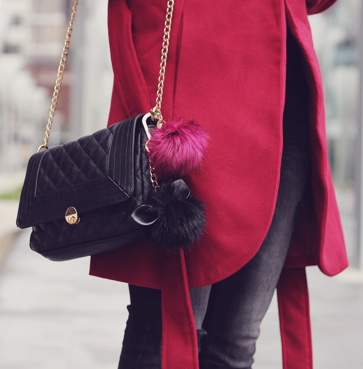 chain clutch bag and pom-poms