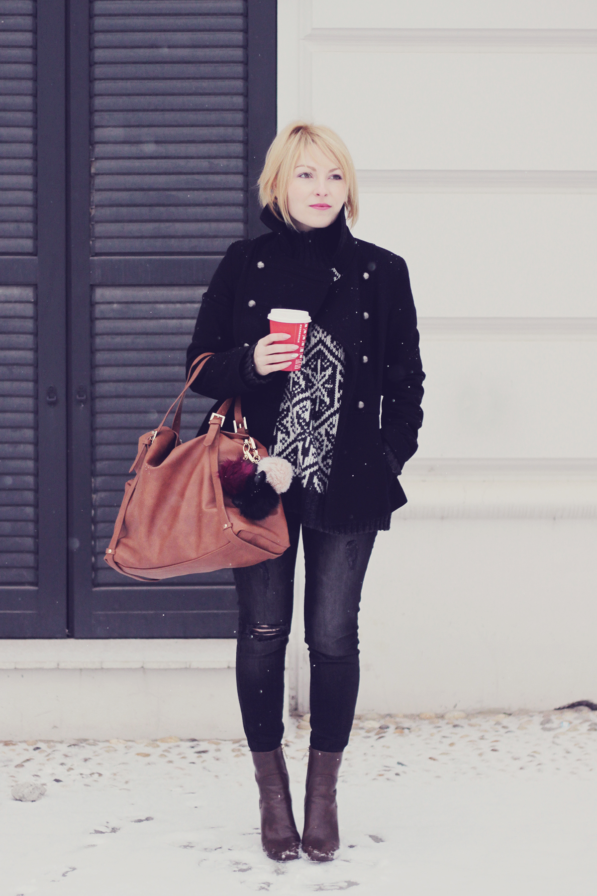 first snow-large tote bag black coat and jeans
