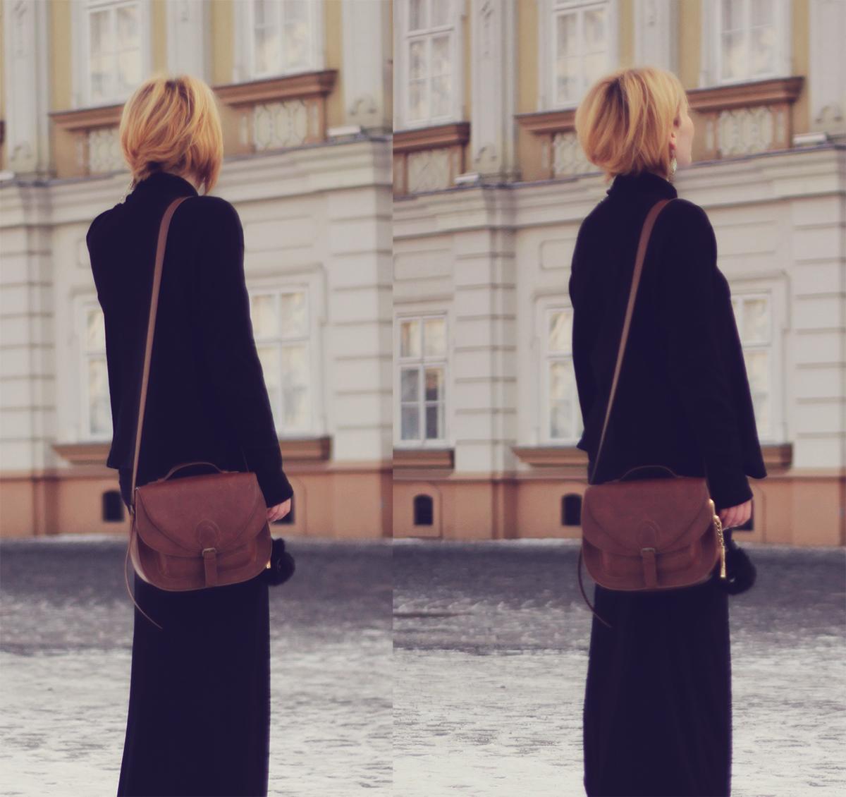 long black skirt and brown shoulder bag