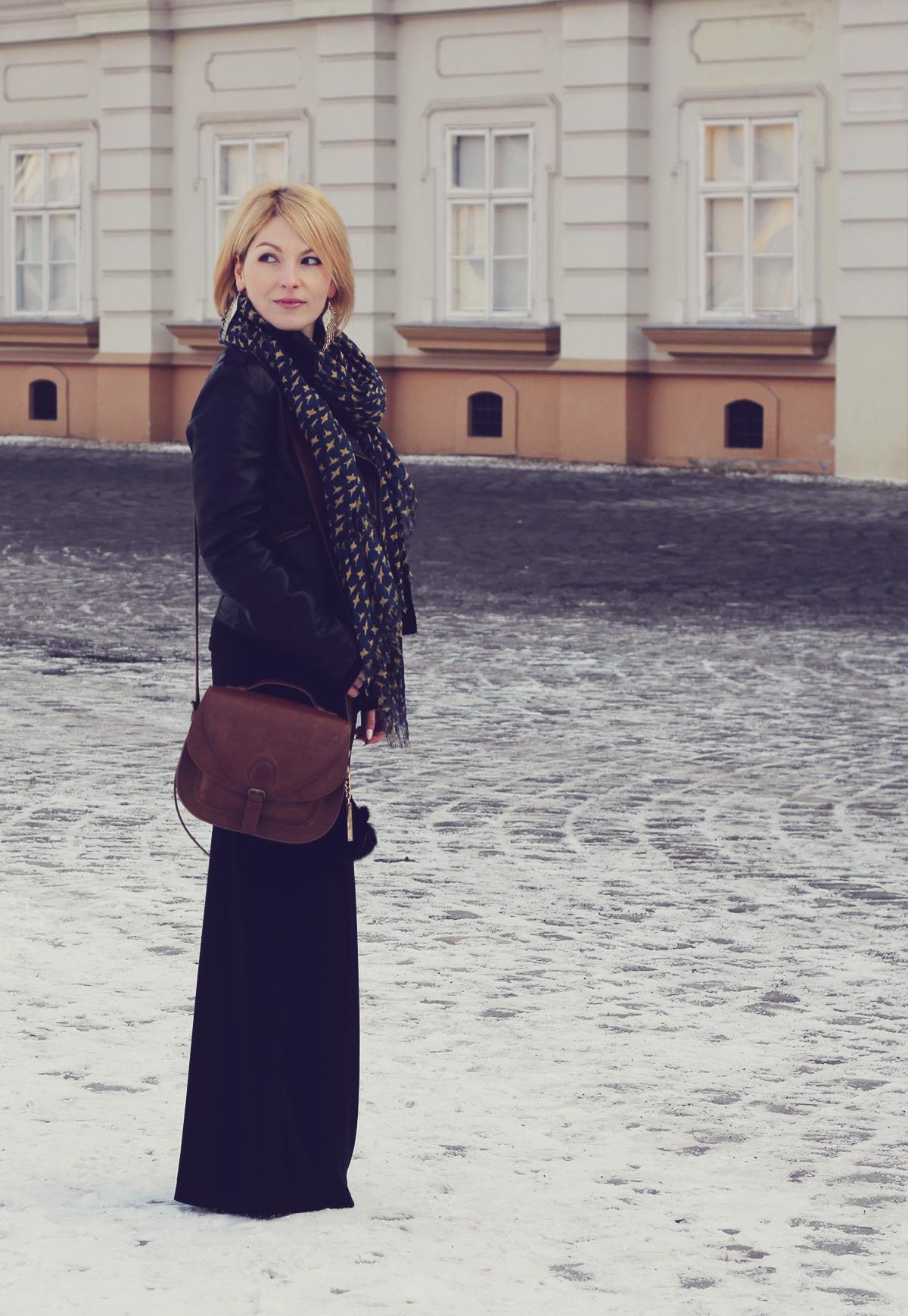 long black skirt and shoulder bag
