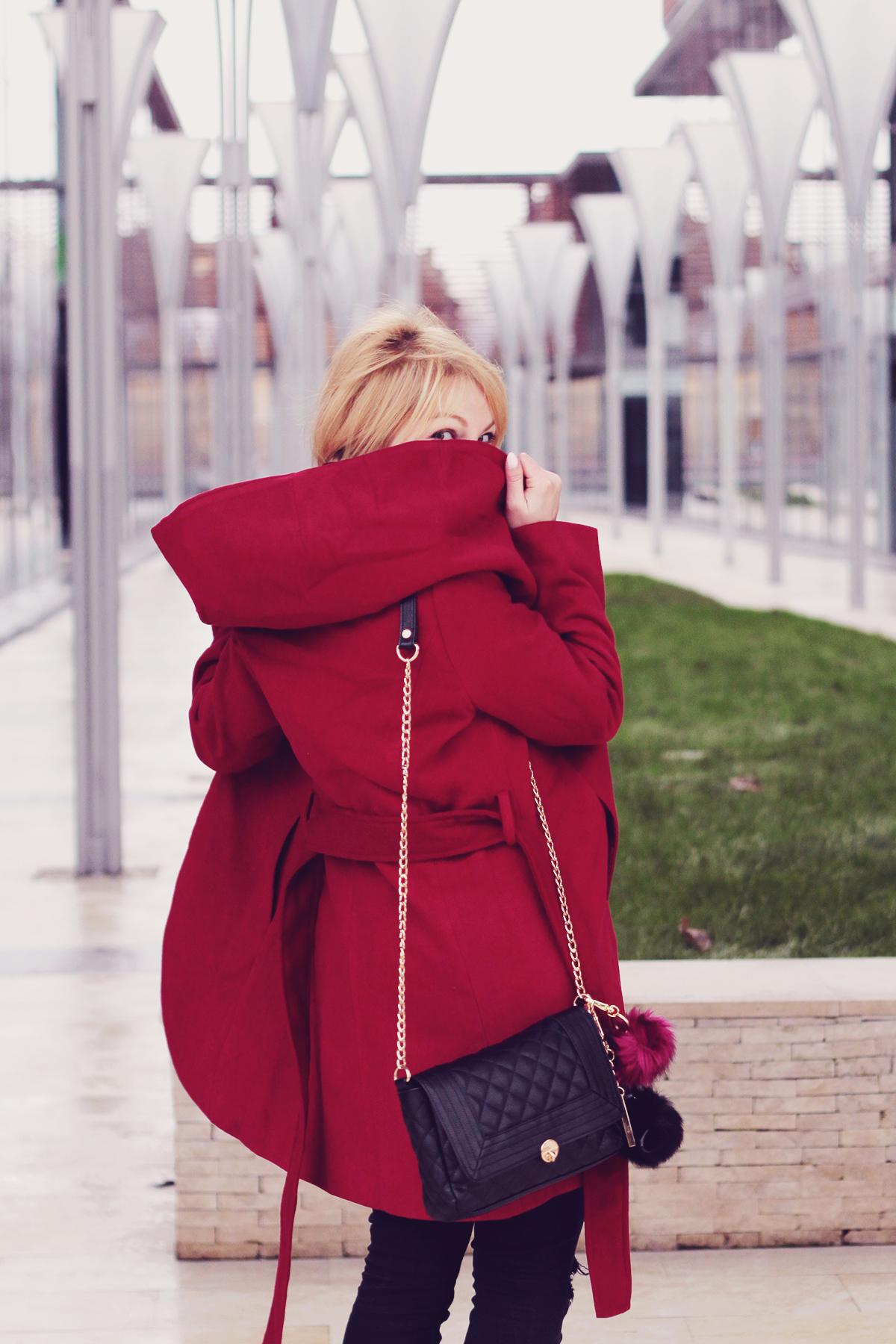 the burgundy coat