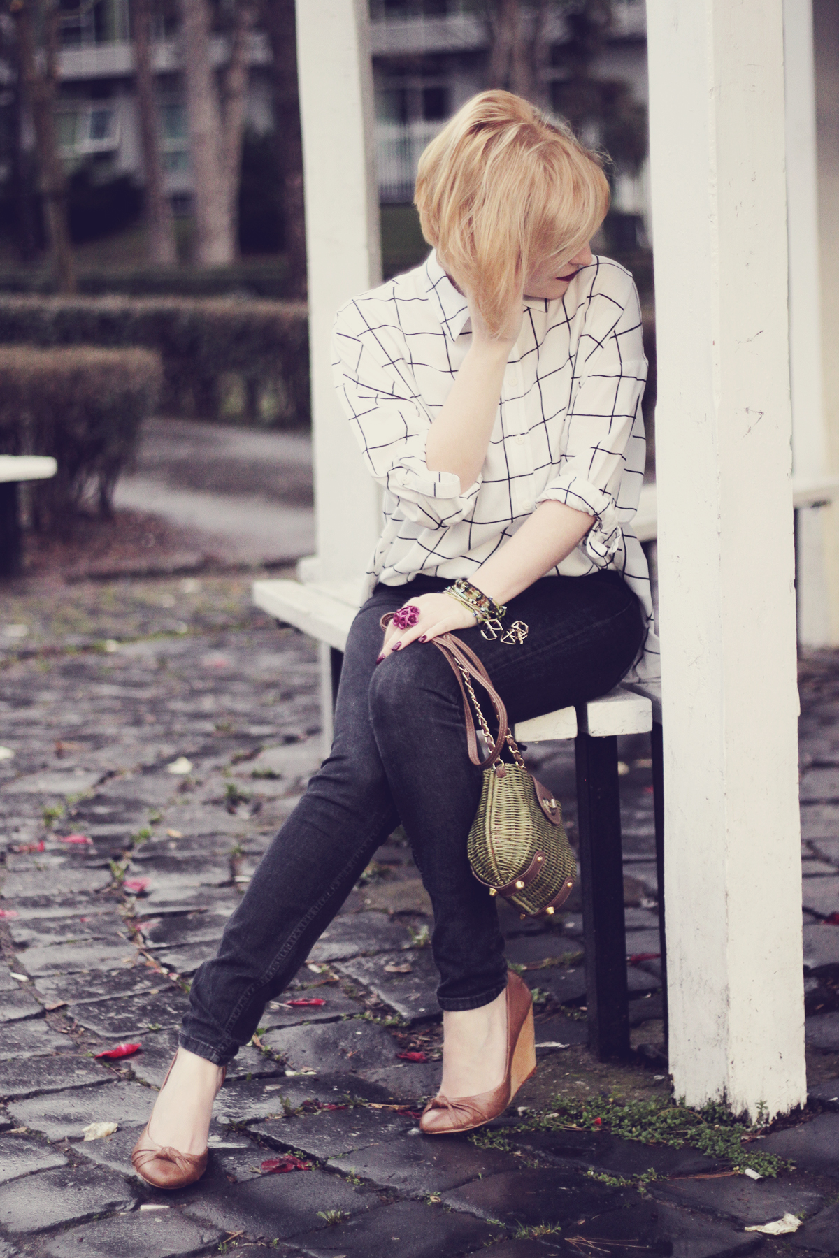 black and white shirt and green purse