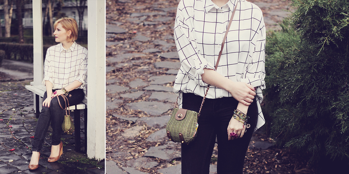 black and white shirt with jeans and green purse