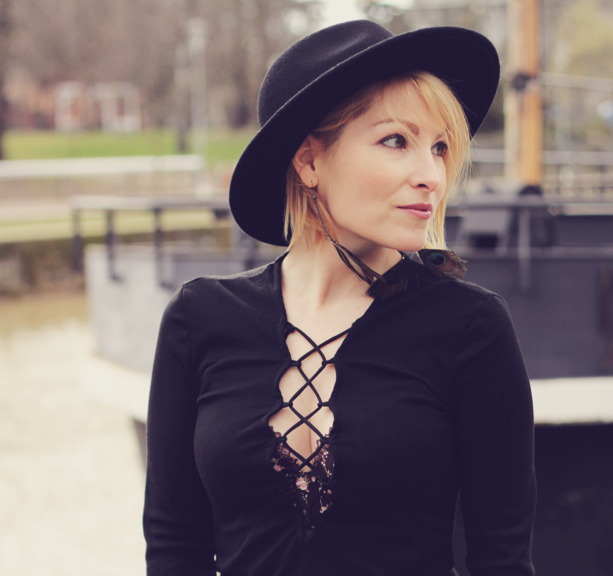 black lace-up top and wool hat