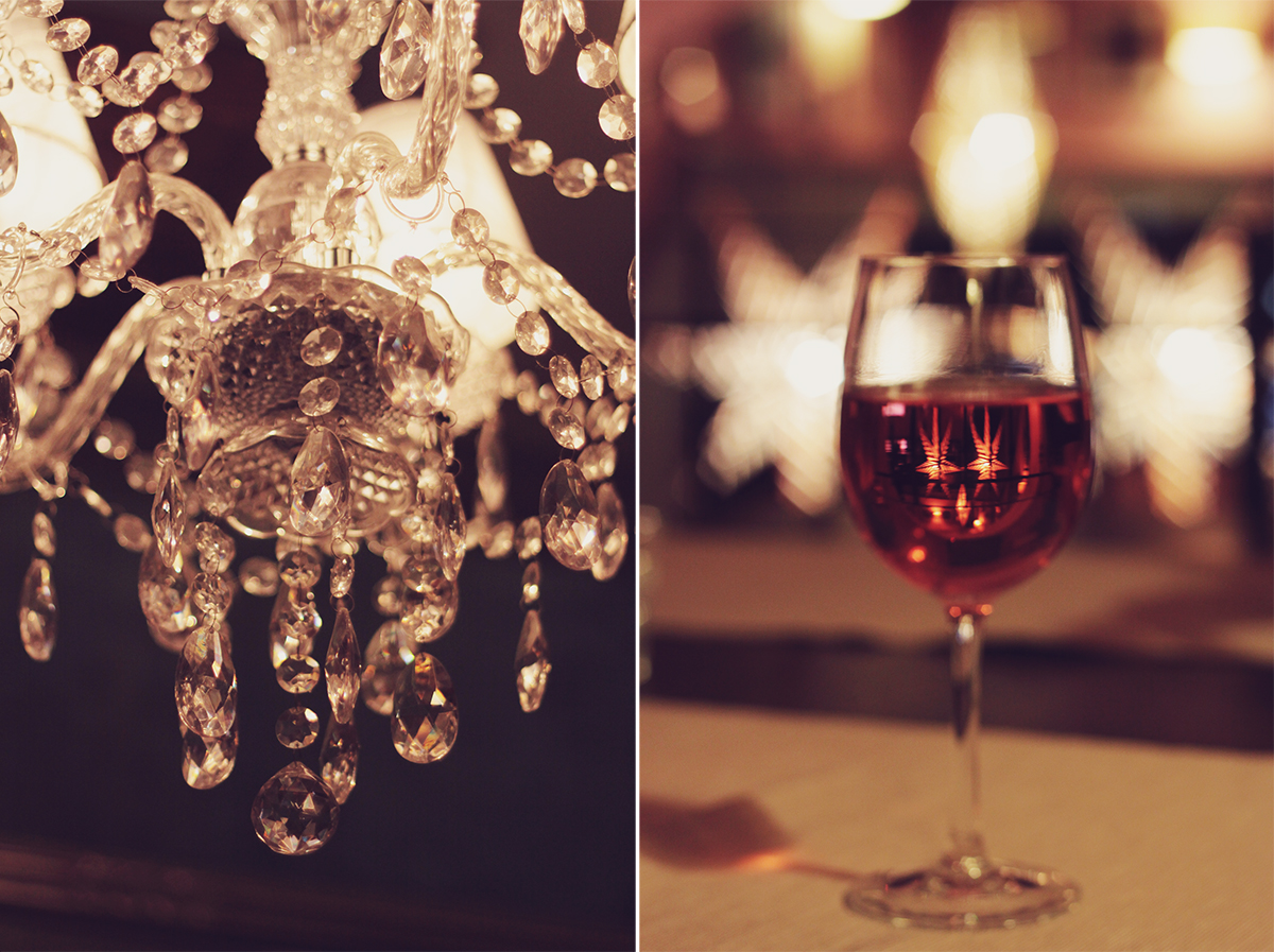 chandelier and glass of wine - szeged hungary
