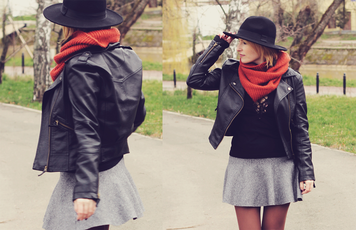 faux-leather jacket and grey skirt