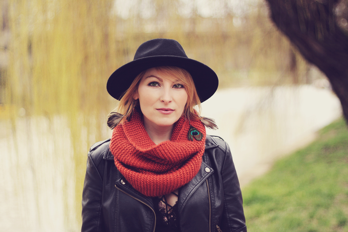 wool hat and faux-leather jacket
