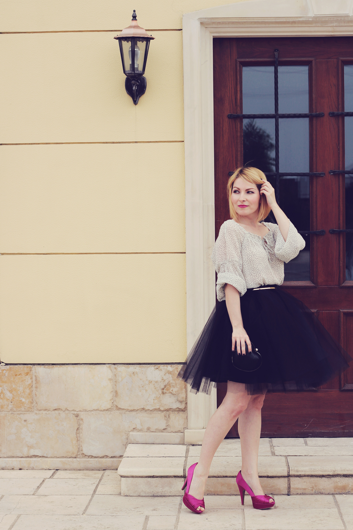 the black tulle skirt and pink peep-toe pumps