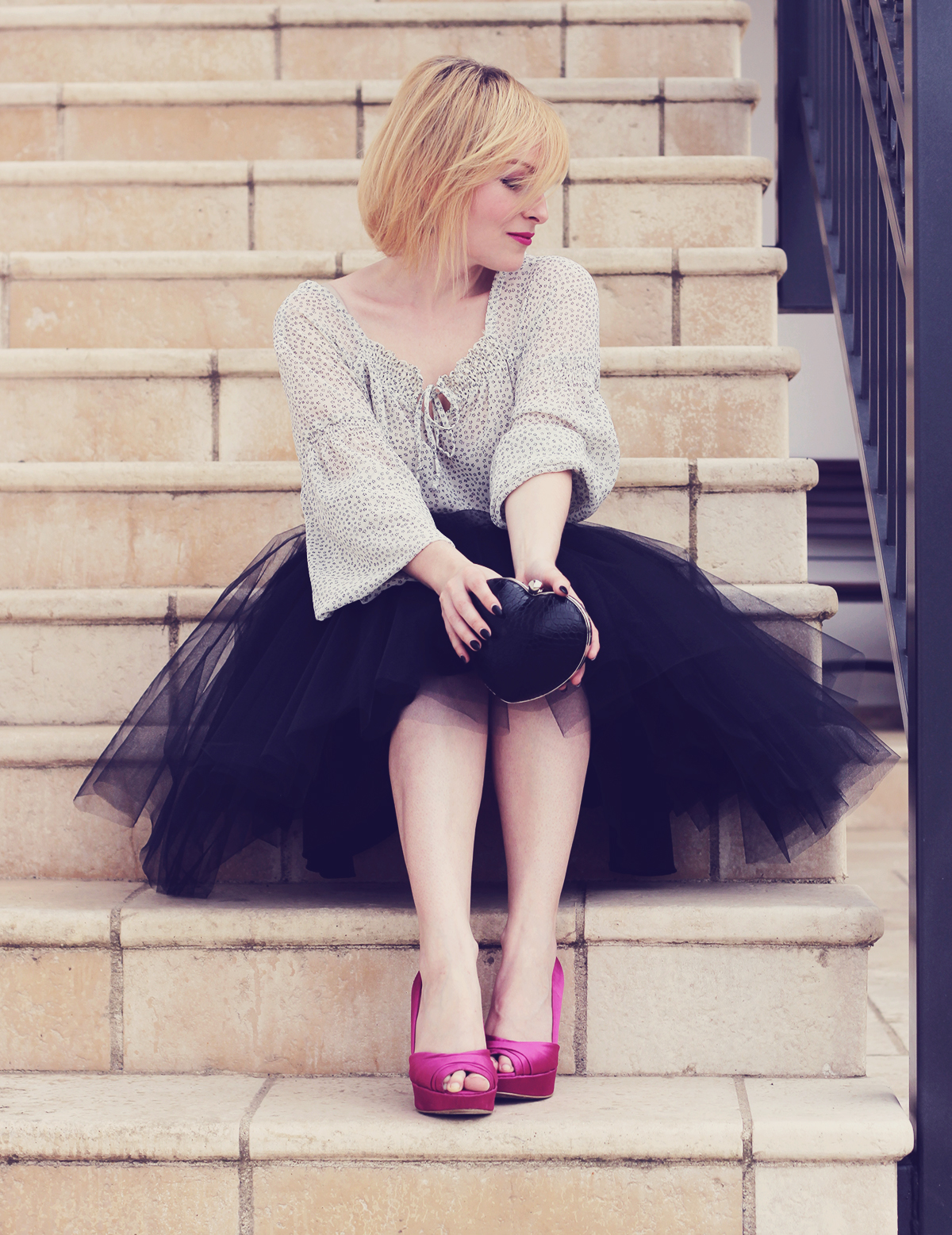 the tulle skirt and heart shaped clutch with pink pumps