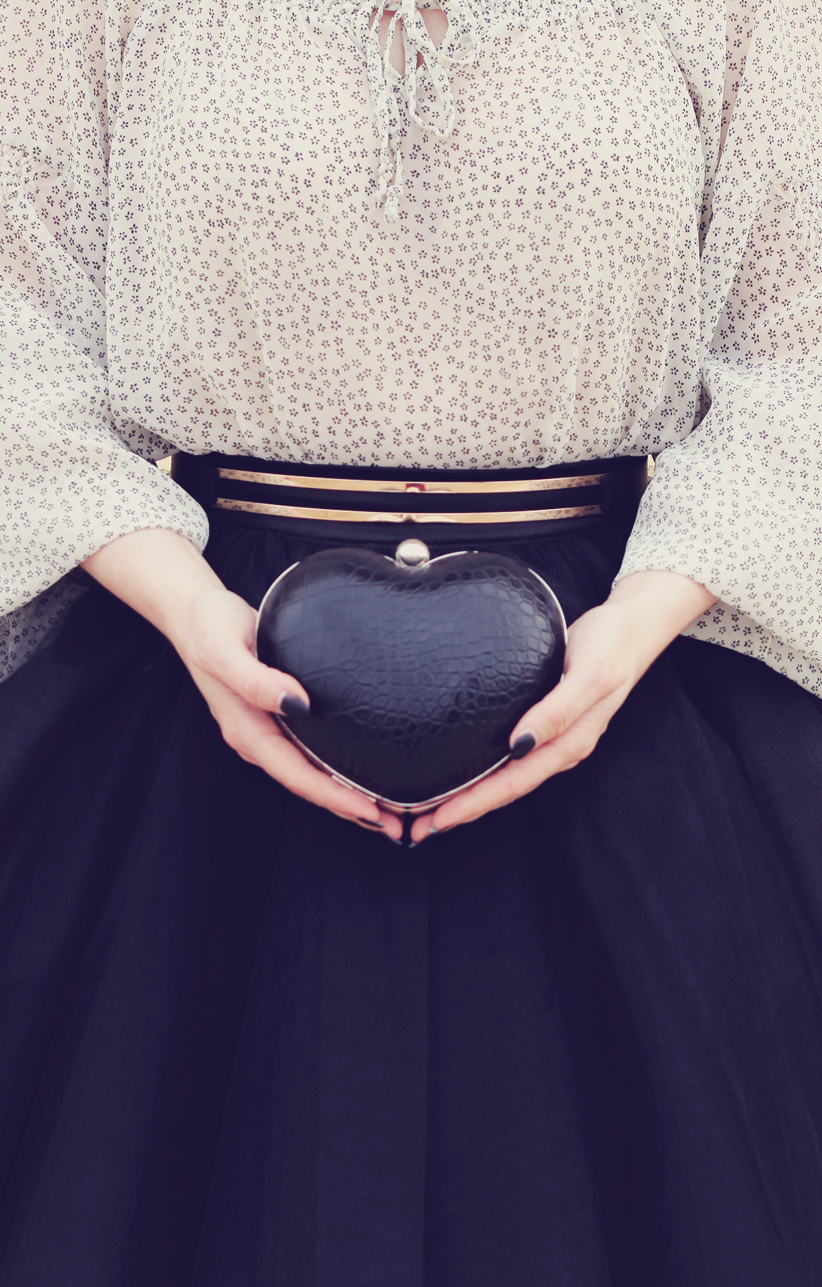 the tulle skirt and heart shaped clutch