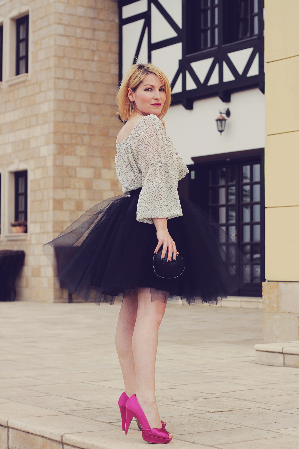 the tulle skirt and pink pumps