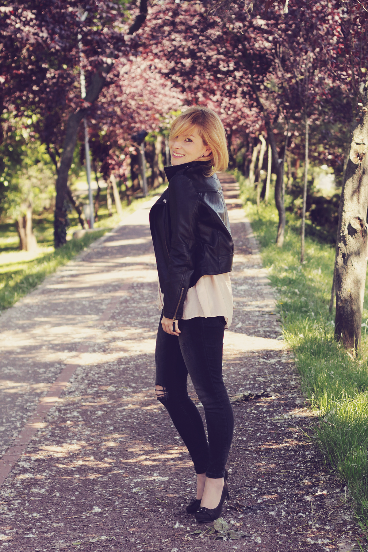 faux leather jacket and charcoal jeans