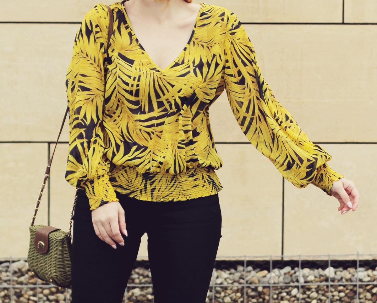 yellow pattern chiffon blouse and green purse