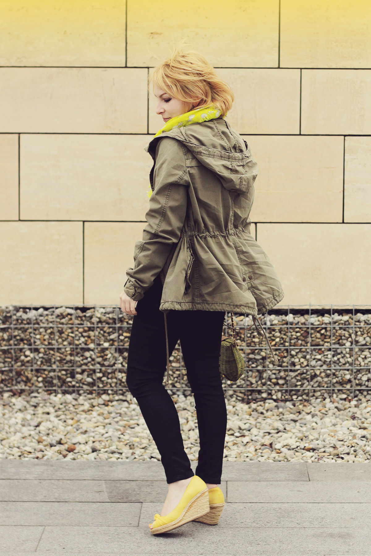 yellow wedges and parka jacket