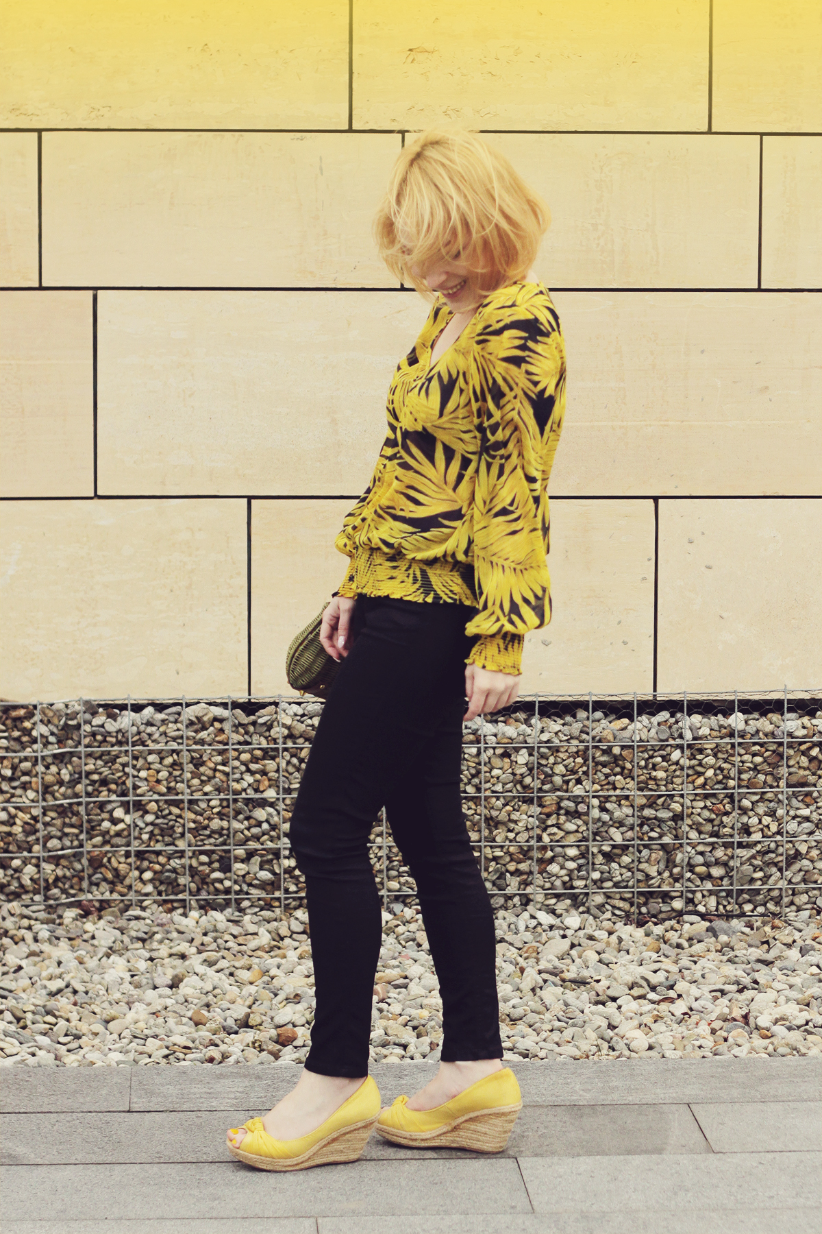 yellow wedges and yellow pattern blouse