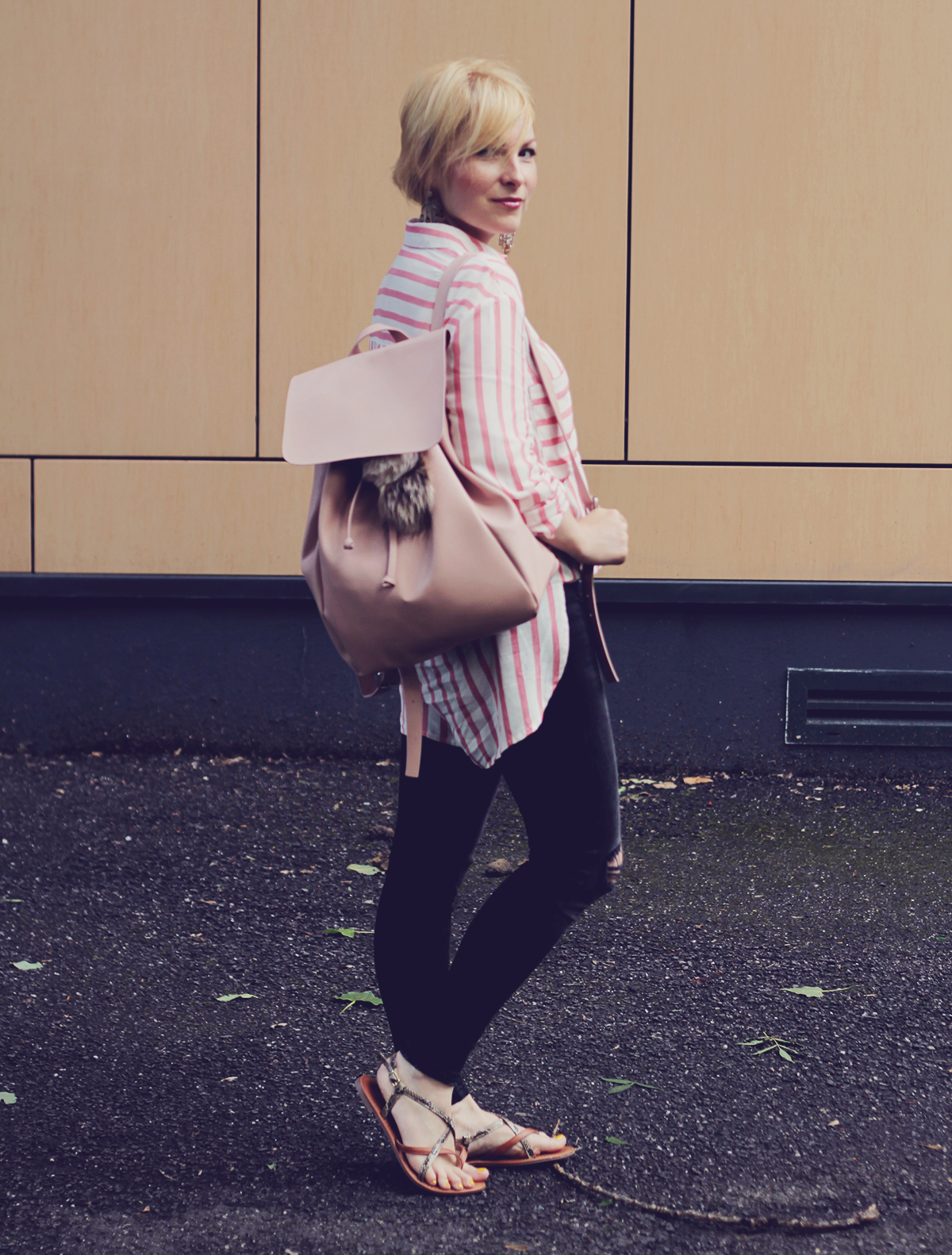 pink backpack and oversized pink stripe shirt