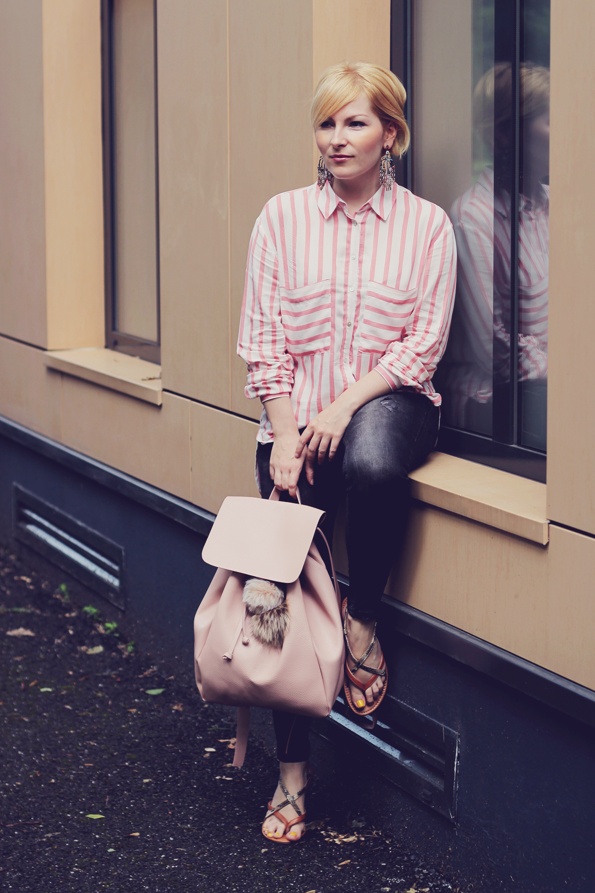 pink backpack and pink stripe shirt with jeans