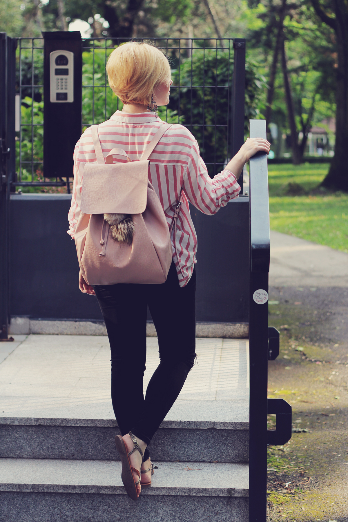 pink backpack and pink stripe shirt with sandals