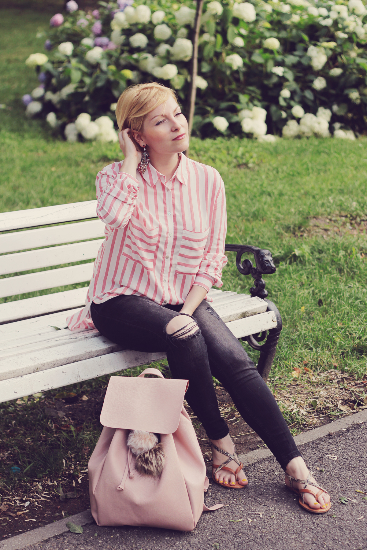 pink backpack and stripe shirt