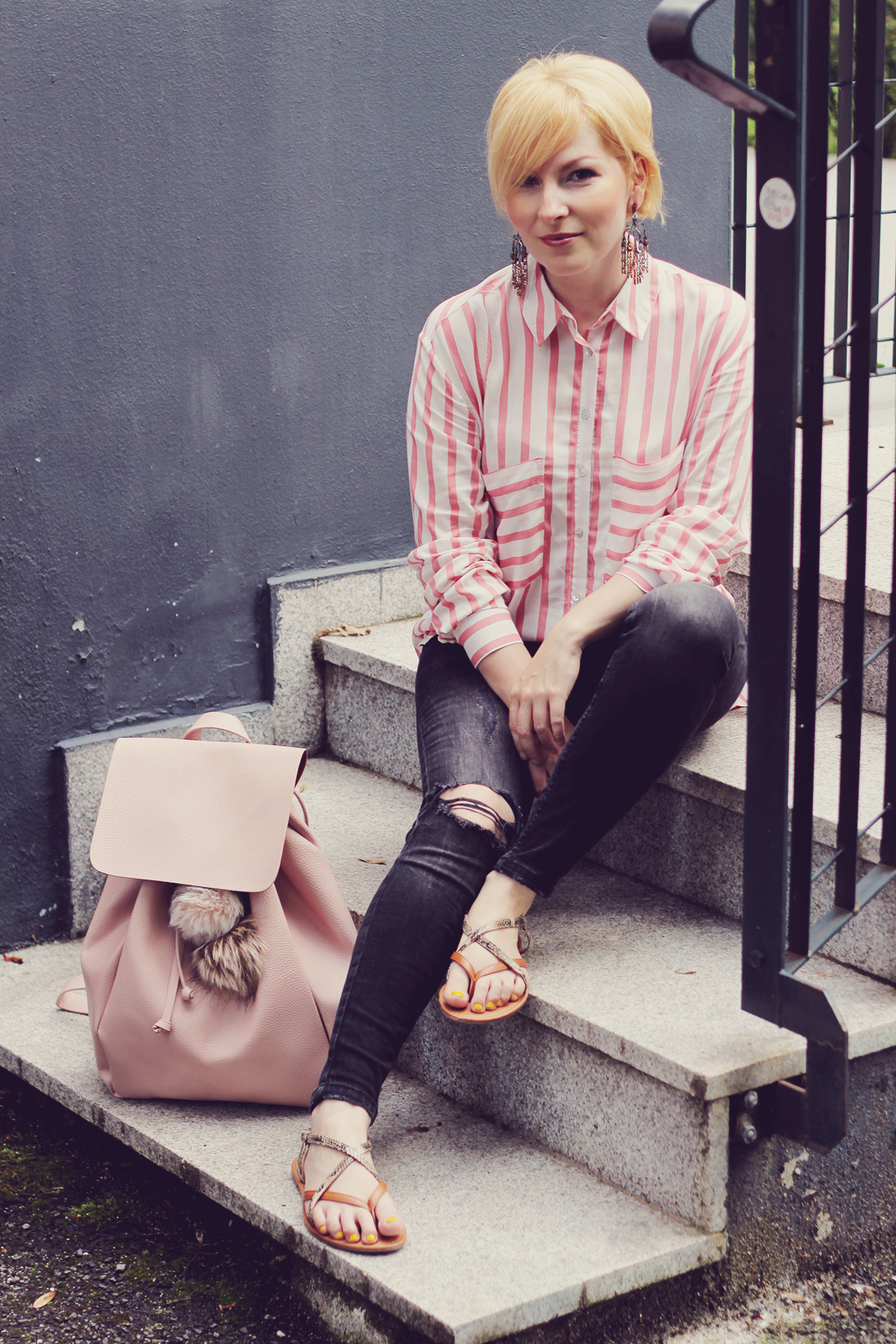 pink backpack with sandals and jeans