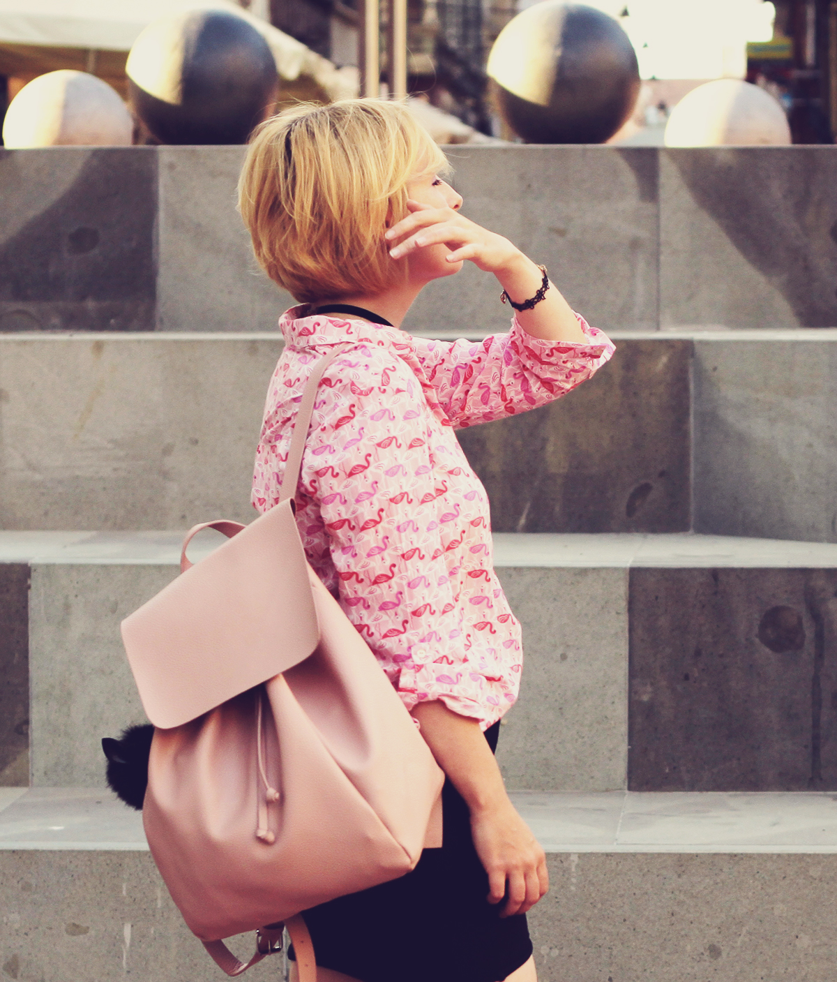 pink flamingo shirt and pink backpack with pom-pom
