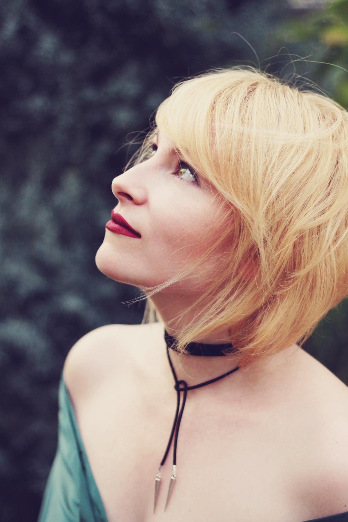 atomic blonde hair, matte berry lips