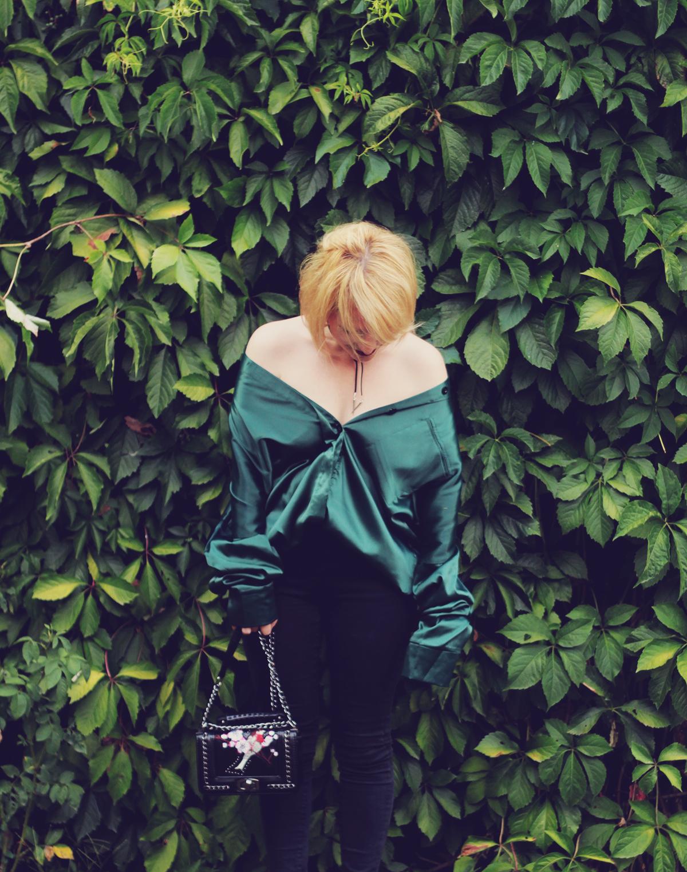 green satin oversized shirt and embroidered shoulder bag