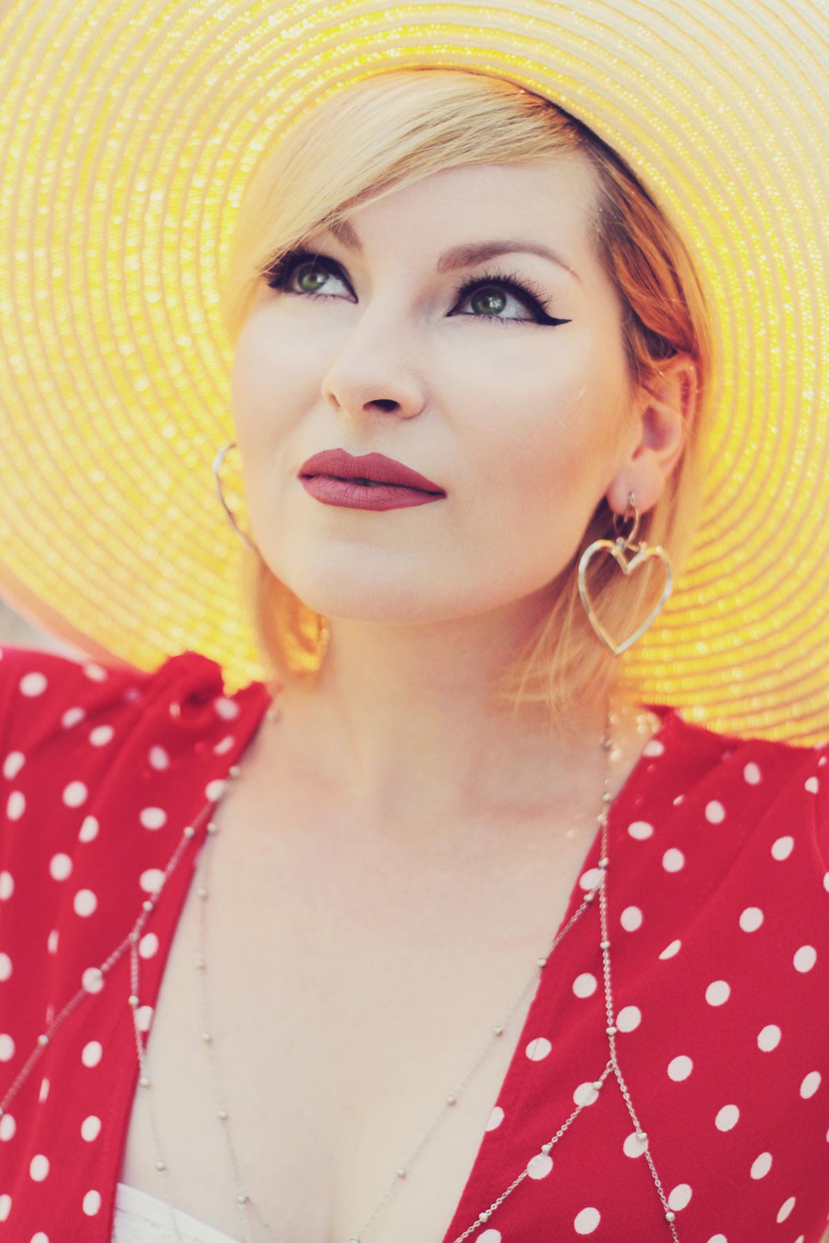 red polka dot dress, matte lips, body chain, straw hat, asymmetric heart earrings, summer