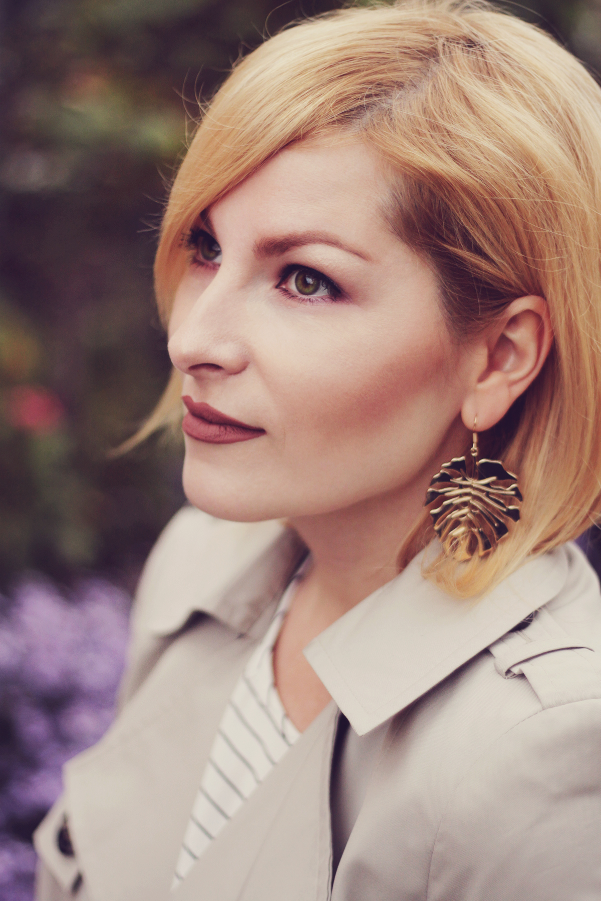 matte lips, tropical leaf earrings, short trench, classic burgundy make-up