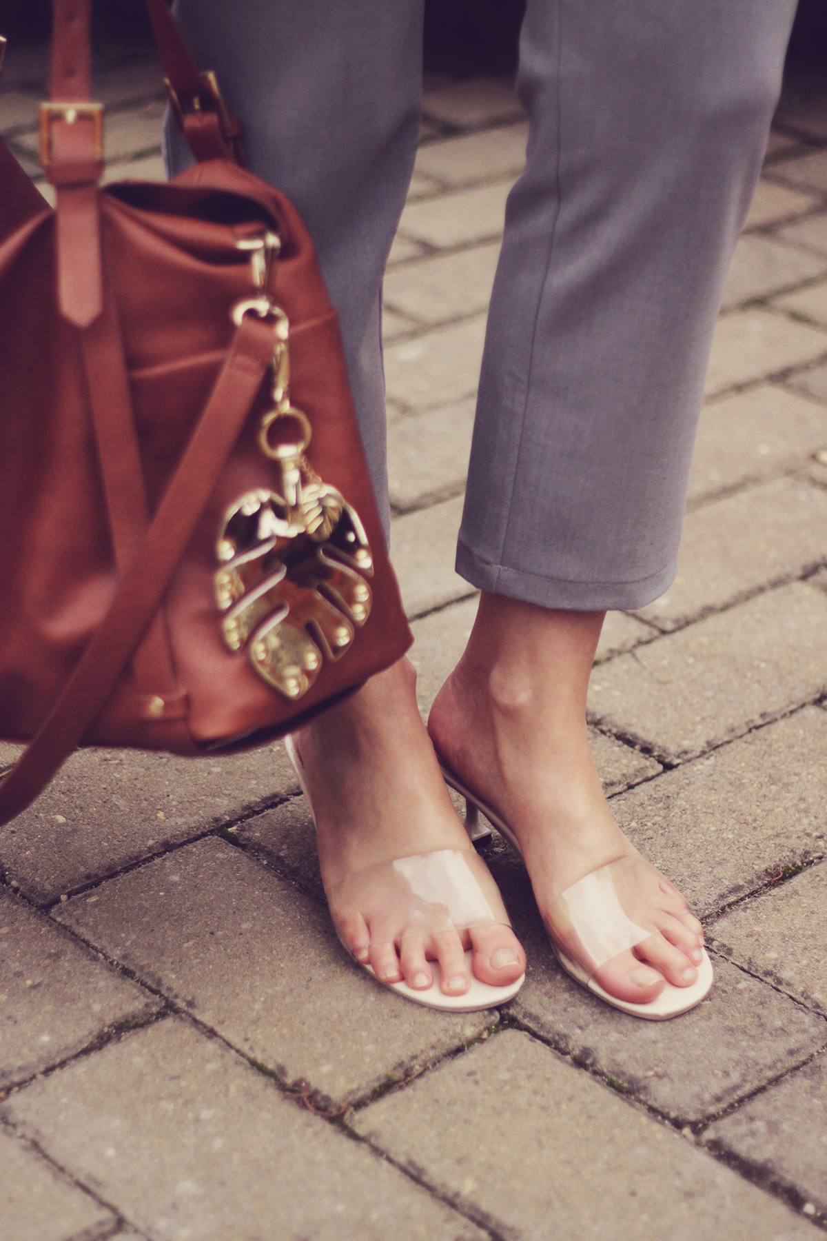 office classic look, transparent kitten heel slippers, brown bag, grey pants, tropical leaf keyring