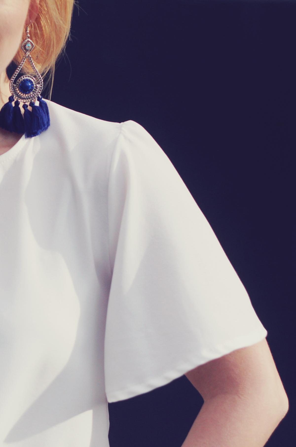 tassel earrings, white top