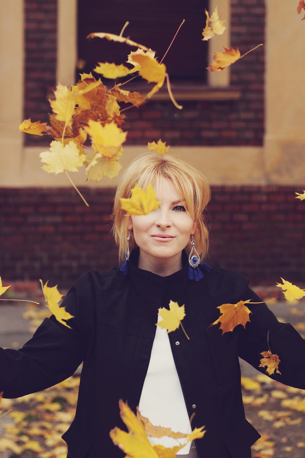autumn, autumn leafs in the air, girl, portrait, tassel earrings, navy jacket, white top