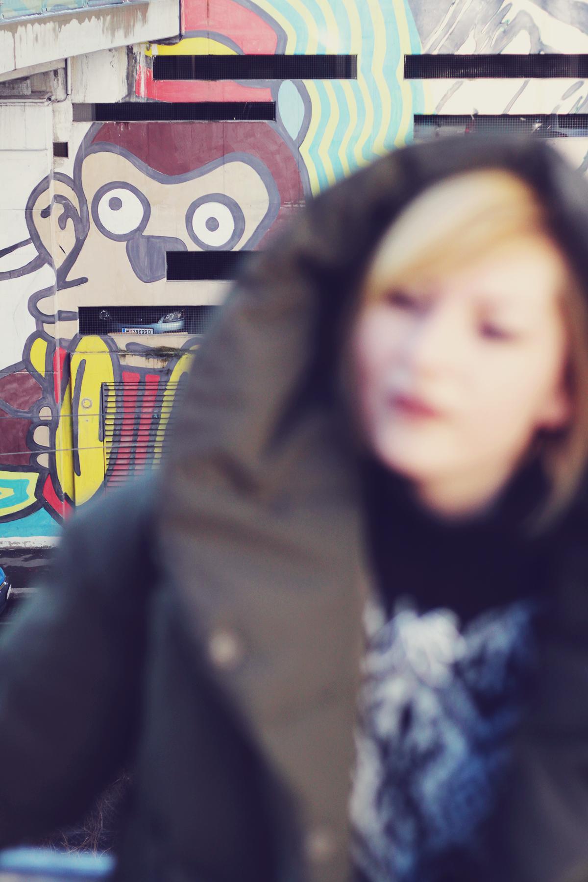 winter fashion, padded jacket, urban landscape, Vienna, graffiti