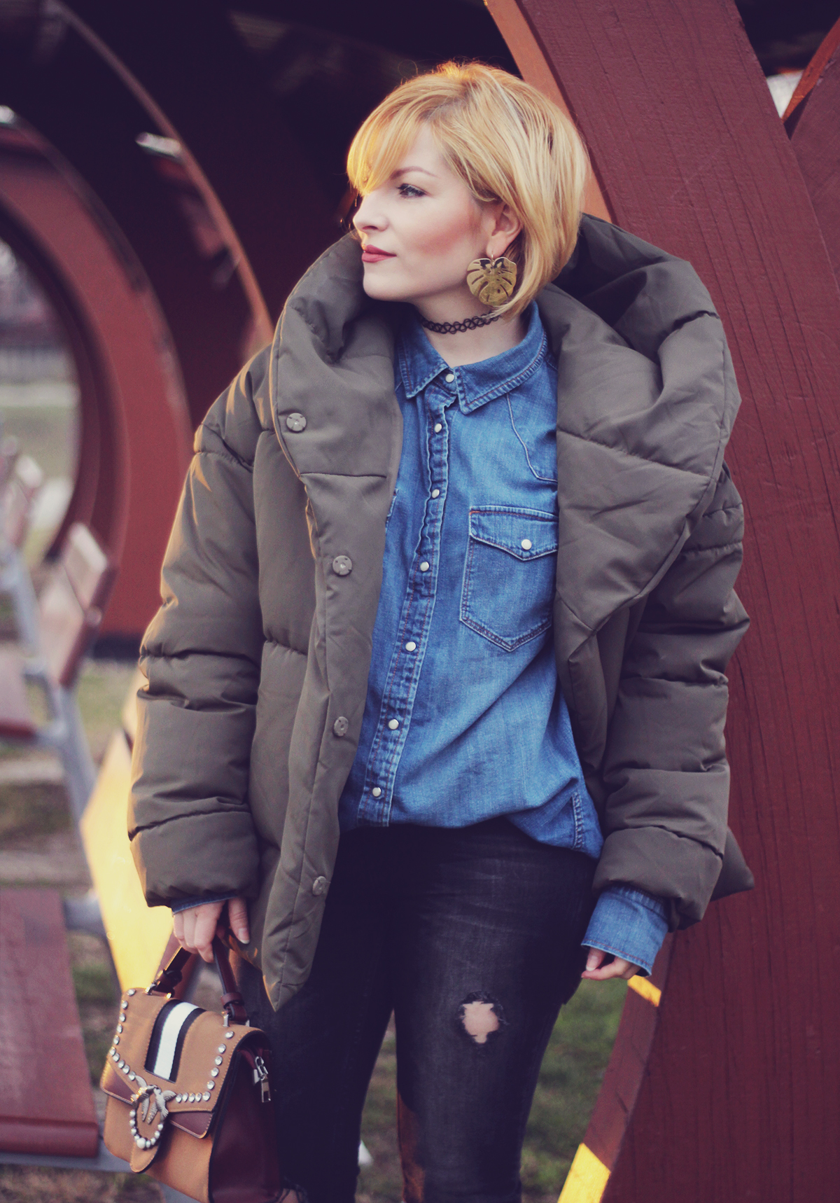 winter fashion, padded jacket, brown bag with bird detail, jeans, matte make-up, leaf earrings, choker