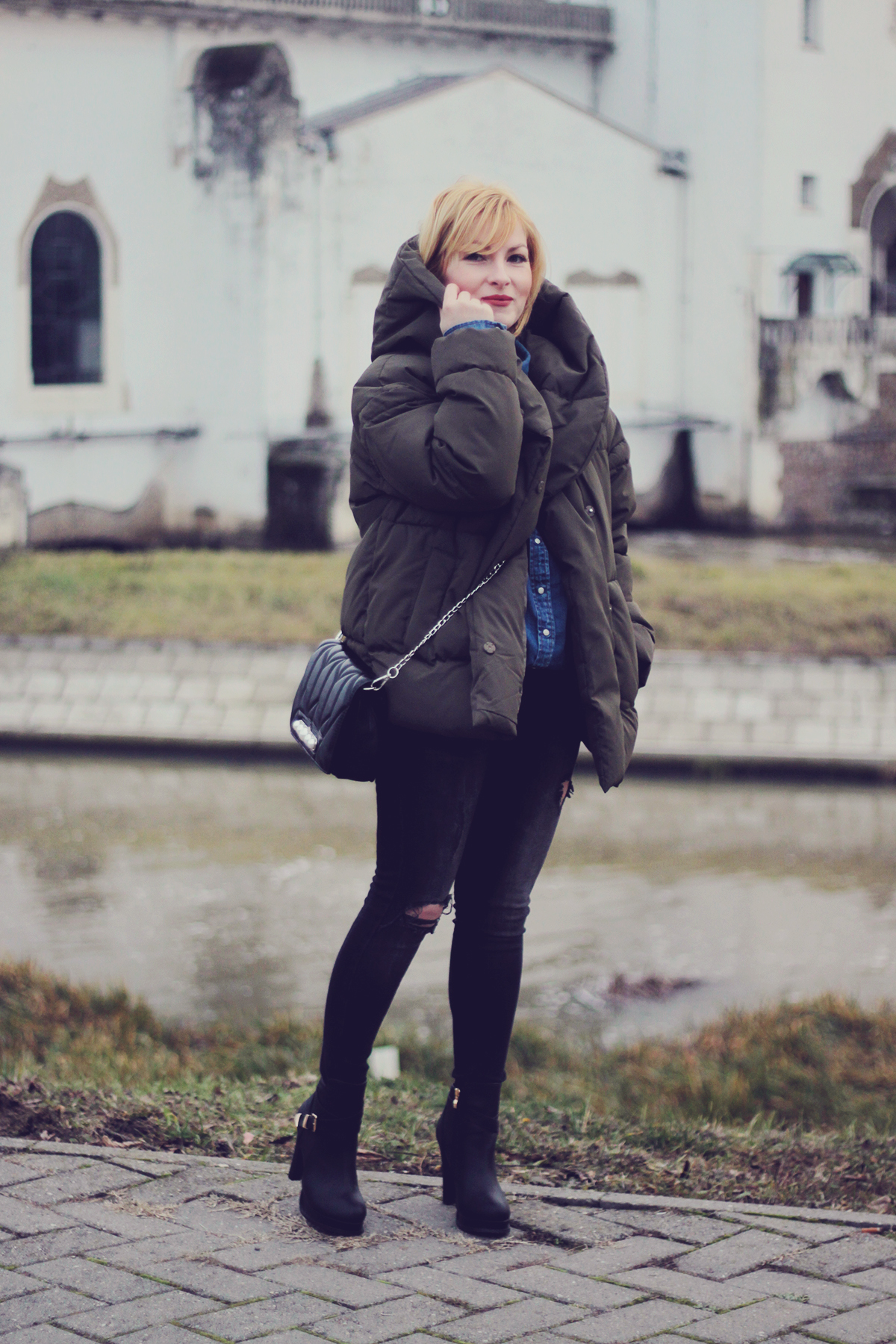 winter fashion, padded jacket, chevron bag with pearl detailing, jeans, high boots, matte make-up, leaf earrings, choker