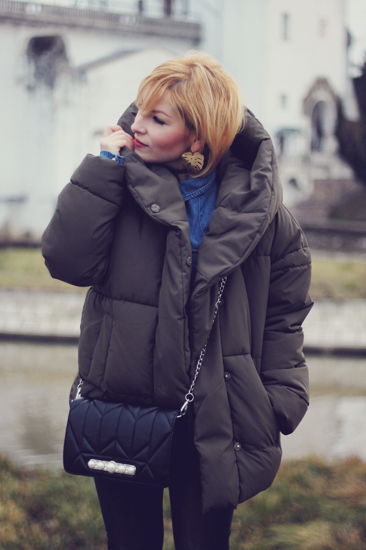 winter fashion, padded jacket, chevron bag with pearl detailing, jeans, matte make-up, leaf earrings, choker